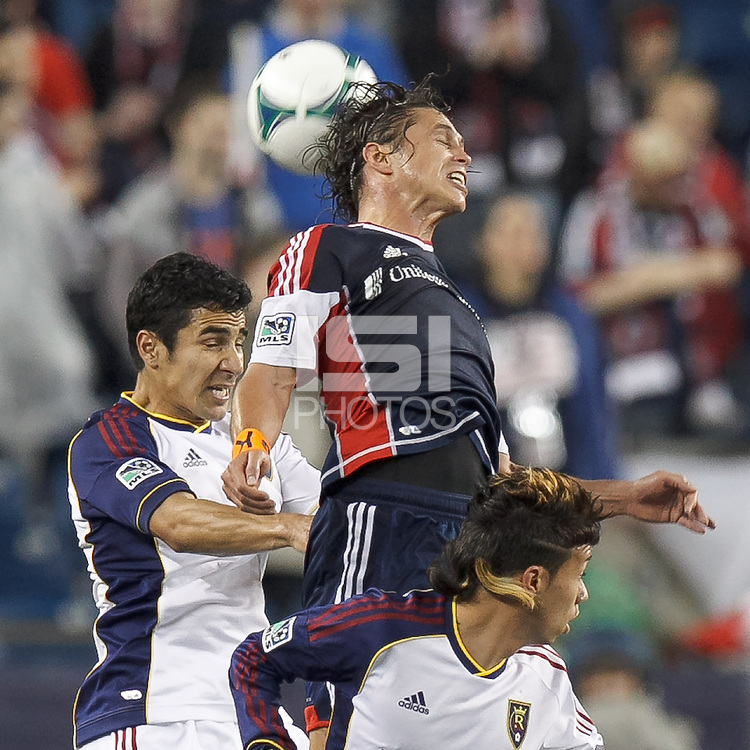 Real Salt Lake defender Tony Beltran (2), New England Revolution midfielder Ryan Guy (13), and Real Salt Lake substitute midfielder Sebastian Velasquez (26) battle for head ball.