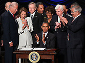 United States President Barack Obama signs the Dodd-Frank Wall Street Reform and Consumer Protection Act before (L-R) Vice President Joe Biden, Speaker of the House Nancy Pelosi (D-CA), Senate Majority Leader Harry Reid (D-NV), Rep. Maxine Waters (D-CA), Sen. Chris Dodd (D-CT) and Rep. Barney Frank (D-MA) at the Ronald Reagan Building, Wednesday, July 21, 2010 in Washington, DC. The bill is the strongest financial reform legislation since the Great Depression and also creates a consumer protection bureau that oversees banks on mortgage lending and credit card practices.  .Credit: Win McNamee - Pool via CNP