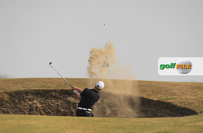 Cathal Butler (Kinsale) plays from a bunker on the 1st during Round 3 of the East of Ireland Amateur Open Championship sponsored by City North Hotel at Co. Louth Golf club in Baltray on Monday 6th June 2016.<br /> Photo by: Golffile | Thos Caffrey