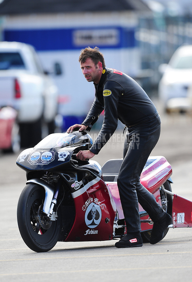 Nov. 11, 2011; Pomona, CA, USA; NHRA pro stock motorcycle rider Fredrik Fredlund during qualifying at the Auto Club Finals at Auto Club Raceway at Pomona. Mandatory Credit: Mark J. Rebilas-.