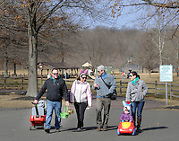EDITORS NOTE: CAPTION CORRECTION: CORRECTS LAUREN MURTA: From left, Chad Munn, Amy Munn, Justin Murta, Luciana Murta, 1.5 years old, and Lauren Murta, all of New Britain, walk through North Branch Park after having there own Easter Egg hunt Saturday March 28, 2015 at North Branch Park in New Britain Township, Pennsylvania. The New Britain East Egg Hunt was cancelled due to field conditions. Alex and Fiona Munn are seated in the wagon , but not seen. (Photo by William Thomas Cain/Cain Images)