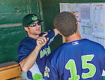8 July 2014: Vermont Lake Monsters Manager David Newhan (left) discusses the lineup with infielder Yairo Munoz prior to facing the Lowell Spinners at Centennial Field in Burlington, Vermont. The Lake Monsters rallied with two runs in the 9th to defeat the Spinners 5-4 in NY Penn League action. Mandatory Credit: Ed Wolfstein Photo *** RAW Image File Available ****