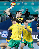 Spain's Gedeon Guardiola (c) and Australia's Mitchell Hedges (l) and Caleb Gahan during 23rd Men's Handball World Championship preliminary round match.January 15,2013. (ALTERPHOTOS/Acero) /NortePhoto