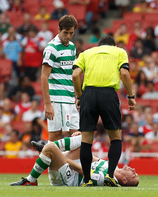 Scott Brown in agony after lunging in to a tackle and has to go off injured