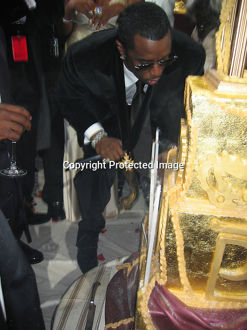 Sean P. Diddy Combs, Kim Porter, Janice Cambs<br />Sean P. Diddy Combs Celebrates his 35th birthday by giving himself a Royal Birthday Ball<br />Cipriani Wall Street<br />New York, NY, USA<br />Thursday, November 04, 2004<br />Photo By Celebrityvibe.com/Photovibe.com, New York, USA, Phone 212 410 5354, email:sales@celebrityvibe.com