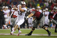 SEATTLE, WA - September 28, 2013: Stanford linebacker Blake Lueders rushes the quarterback as Washington State offensive linesman Gunnar Eklund tries to block during play at CenturyLink Field. Stanford won 55-17.