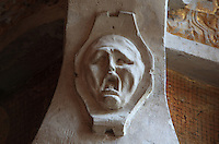 Ghostly head with expression of despair in carved stucco from a frame of a fresco by Rosso Fiorentino, 1535-37, in the Galerie Francois I, begun 1528, the first great gallery in France and the origination of the Renaissance style in France, Chateau de Fontainebleau, France. The Palace of Fontainebleau is one of the largest French royal palaces and was begun in the early 16th century for Francois I. It was listed as a UNESCO World Heritage Site in 1981. Picture by Manuel Cohen