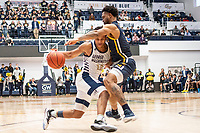WASHINGTON, DC - FEBRUARY 22: Armel Potter #2 of George Washington powers his way past Scott Spencer #2 of La Salle during a game between La Salle and George Washington at Charles E Smith Center on February 22, 2020 in Washington, DC.
