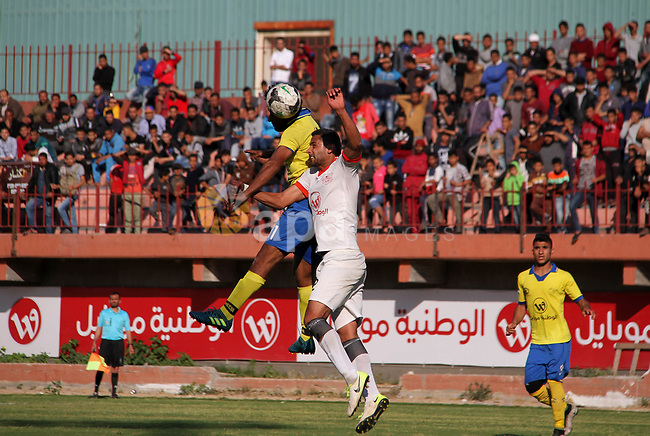"Palestinian players of Shabab Jabalia club ""yellow"" and players of Shabab Khan Younis club ""white"" compete during a football match of semi final Gaza Cup, at Palestine stadium, in Gaza city on April 23, 2018. Photo by Mahmoud Ajour"
