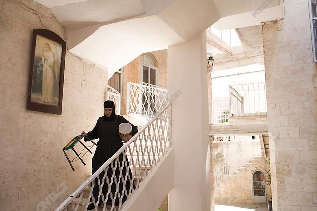 A nun at Seydanaya monastery near Damascus, Syria.
