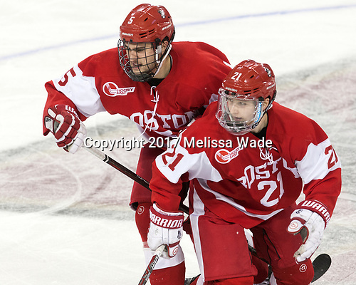 Chad Krys (BU - 5), Patrick Harper (BU - 21) - The visiting Boston University Terriers defeated the Boston College Eagles 3-0 on Monday, January 16, 2017, at Kelley Rink in Conte Forum in Chestnut Hill, Massachusetts.