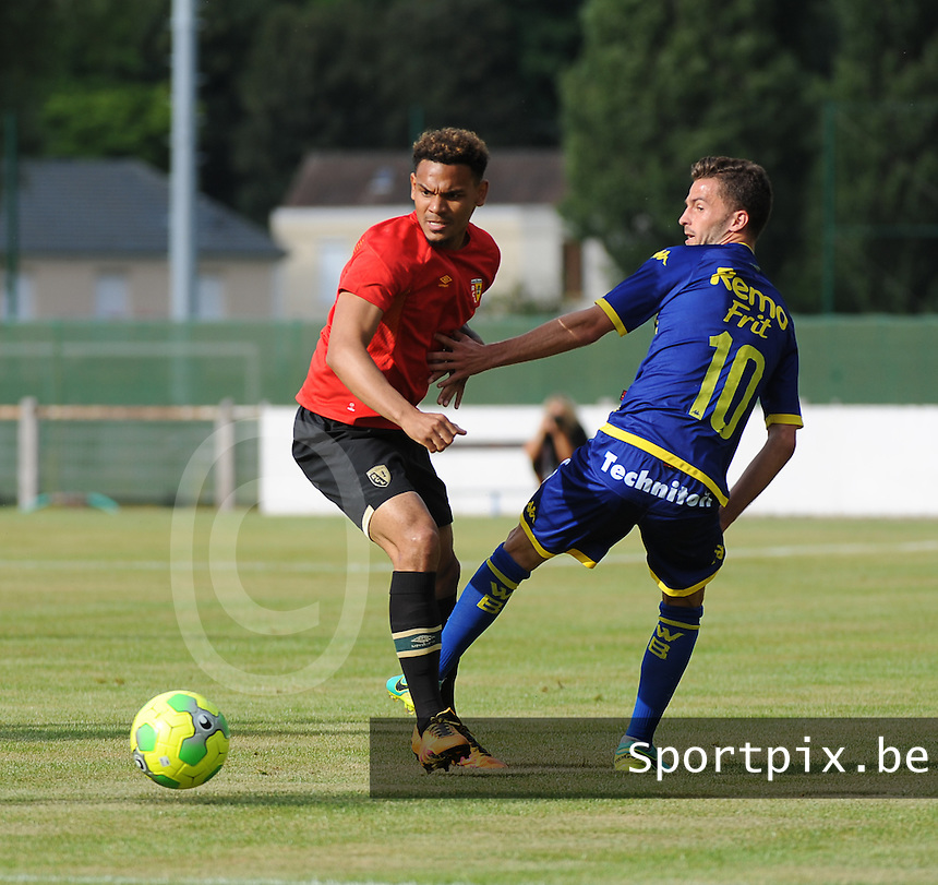 20160713 - DOUAI , FRANCE : RC Lens' Kenny Lala (L) and Waasland Beveren's Siebe Schrijvers (R) pictured during a friendly game between Racing Club de LENS and Waasland Beveren during the preparations for the 2016-2017 season , Wednesday 13 July 2016 ,  PHOTO Dirk Vuylsteke | Sportpix.Be