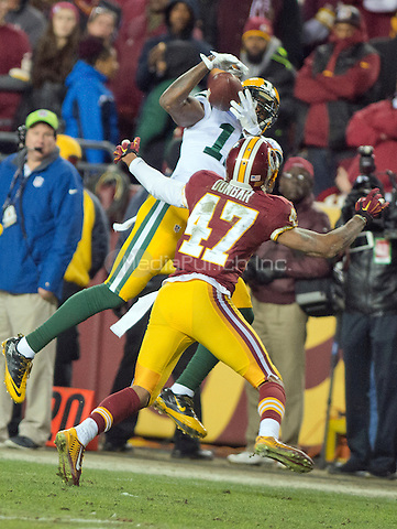 Green Bay Packers wide receiver Davante Adams (17) makes a catch over Washington Redskins cornerback Quinton Dunbar (47) in second quarter action during an NFC Wild Card game at FedEx Field in Landover, Maryland on Sunday, January 10, 2016.  The Packers won the game 35 - 18.<br /> Credit: Ron Sachs / CNP/MediaPunch ***FOR EDITORIAL USE ONLY***
