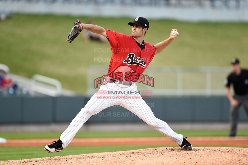 Birmingham Barons pitcher Scott Snodgress (47) delivers a pitch during a game against the Tennessee Smokies on April 22, 2014 at Regions Field in Birmingham, Alabama.  Birmingham defeated Tennessee 14-3.  (Mike Janes/Four Seam Images)