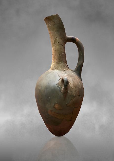 Hittite long neck beak spout pointed base terra cotta vessel. Hittite Old Period, 1650 - 1450 BC. Huseyindede. Çorum Archaeological Museum, Corum, Turkey. Against a grey bacground.