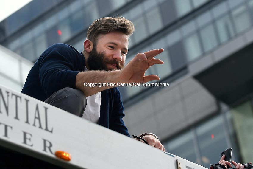 February 4, 2015 - Boston, Massachusetts, U.S. - New England Patriots wide receiver Julian Edelman (11) waves to fans during a parade held in Boston to celebrate the team's victory over the Seattle Seahawks in Super Bowl XLIX. Eric Canha/CSM
