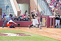 Softball team in action vs Florida during Super Bulldog Weekend.<br />  (photo by Beth Wynn / &copy; Mississippi State University)