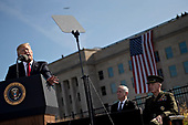 United States President Donald J. Trump, left, speaks as General Joseph Dunford, Chairman of the Joint Chiefs of Staff, right and Jim Mattis, US Secretary of Defense, listen, during a ceremony to commemorate the September 11, 2001 terrorist attacks, at the Pentagon in Washington, D.C., U.S., on Monday, Sept. 11, 2017. Trump is presiding over his first 9/11 commemoration on the 16th anniversary of the terrorist attacks that killed nearly 3,000 people when hijackers flew commercial airplanes into New York's World Trade Center, the Pentagon and a field near Shanksville, Pennsylvania. <br /> Credit: Andrew Harrer / Pool via CNP