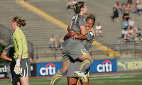 Philadelphia forwards, Amy Rodriguez (8) and Lianne Sanderson (10) share a hug after Rodriguez scored the game-winning goal.  Philadelphia Independence defeated Sky Blue, 2-1, at John Farrell Stadium in West Chester, PA.