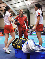 17 OCT 2009 - LOUGHBOROUGH, GBR - Julian Robertson guides Jessica Fletcher and Jenny Wallwork during their womens doubles match at the Team England v Japan International (PHOTO (C) NIGEL FARROW)