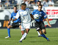24 October 2004:  Brian Mullan of Earthquakes fights for the ball with Jose Burciaga, Jr. of Wizards at Spartan Stadium in San Jose, California.     Earthquakes defeated Wizards, 2-0.  Credit: Michael Pimentel / ISI