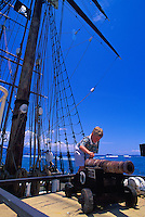 Young boy playing with the cannon on the brig the Carthaginian III, a 19th-century replica of a typical brig used in the whaling days of Lahaina. From 1820-circa.1860, Lahaina was the whaling capital of the world.