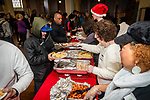 WATERBURY, CT. 21 December 2019-122119BS300 - A hot meal is given out by volunteers for those in attendance, during a Christmas Party for the less fortunate and homeless at the Basilica of Immaculate Conception in Waterbury on Saturday. Bill Shettle Republican-American