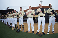 The Wake Forest Demon Deacons stand for the National Anthem prior to the game against the Notre Dame Fighting Irish at David F. Couch Ballpark on March 10, 2019 in  Winston-Salem, North Carolina. The Demon Deacons defeated the Fighting Irish 7-4 in game one of a double-header.  (Brian Westerholt/Four Seam Images)