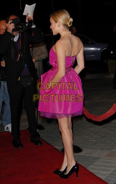 "CHLOE SEVIGNY.The Paramount Pictures L.A Premiere of ""Zodiac"" held at Paramount Studios in Hollywood, California, USA..March 1st, 2007.full length pink dress hand in pocket strapless back behind rear black shoes .CAP/DVS.©Debbie VanStory/Capital Pictures"