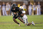 Greg Dortch (89) of the Wake Forest Demon Deacons fights for extra yards as Lawrence Austin (20) of the Georgia Tech Yellow Jackets attempts to make a tackle during second half action at Bobby Dodd Stadium on October 21, 2017 in Atlanta, Georgia.  The Yellow Jackets defeated the Demon Deacons 38-24. (Brian Westerholt/Sports On Film)
