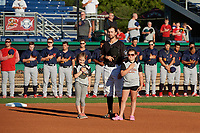 Batavia Muckdogs Harrison DiNicola (24) during the national anthem with young fans before a NY-Penn League game against the State College Spikes on July 1, 2019 at Dwyer Stadium in Batavia, New York.  Batavia defeated State College 5-4.  (Mike Janes/Four Seam Images)