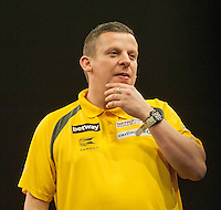 09.04.2015. Sheffield, England. Betway Premier League Darts. Matchday 10.  Dave Chisnall [ENG] in action during his game with Gary Anderson [SCO]