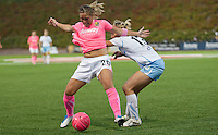 Natalie Spilger (right) pulls on the shirt of Camile Abily (left). FC Gold Pride tied the Chicago Red Stars 0-0 in PUMA's Project Pink, Think Pink, Breast Cancer Awareness game at Pioneer Stadium in Hayward, California on August 7th, 2010.