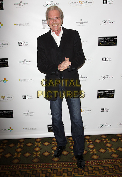 PAT O'BRIEN .City of Hope Pre-Oscar gifting suite held At The Intercontinental Hotel, Century City, California, USA, 6th March 2010..full length black jacket suit blazer jeans hands .CAP/ADM/KB.©Kevan Brooks/Admedia/Capital Pictures