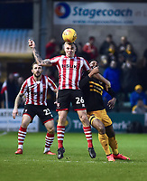 Lincoln City's Harry Anderson vies for possession with  Newport County's Jamille Matt<br /> <br /> Photographer Andrew Vaughan/CameraSport<br /> <br /> The EFL Sky Bet League Two - Lincoln City v Newport County - Saturday 22nd December 201 - Sincil Bank - Lincoln<br /> <br /> World Copyright © 2018 CameraSport. All rights reserved. 43 Linden Ave. Countesthorpe. Leicester. England. LE8 5PG - Tel: +44 (0) 116 277 4147 - admin@camerasport.com - www.camerasport.com