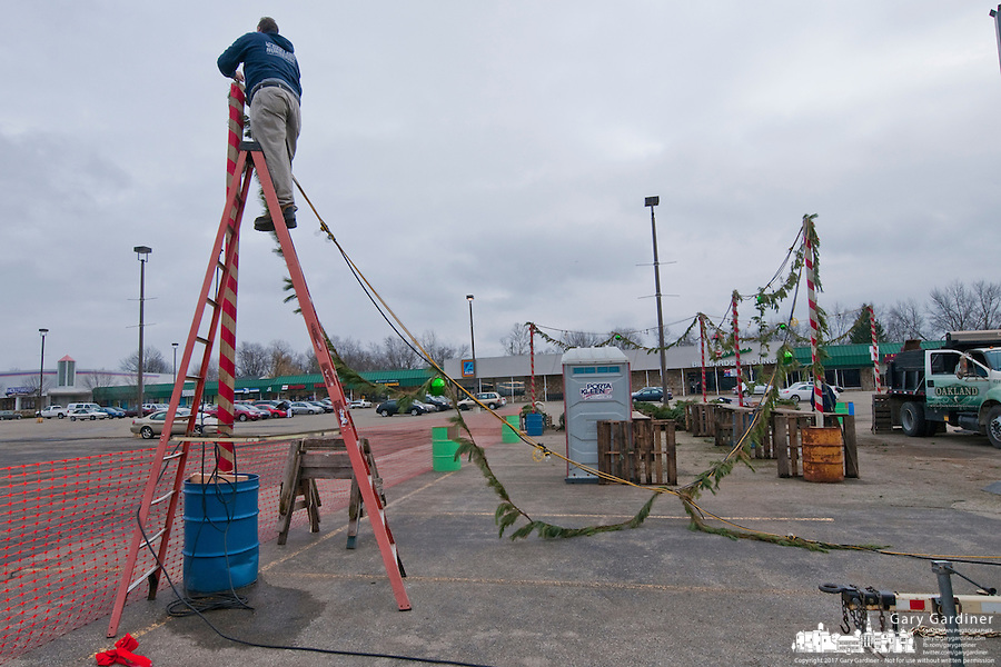 Greg Schilling of Oakland Nursery dismantles the lighting use to illuminate the company's Christmas tree sales lot at Glengary Shopping Center. The sales lot opened the day after Thanksgiving.