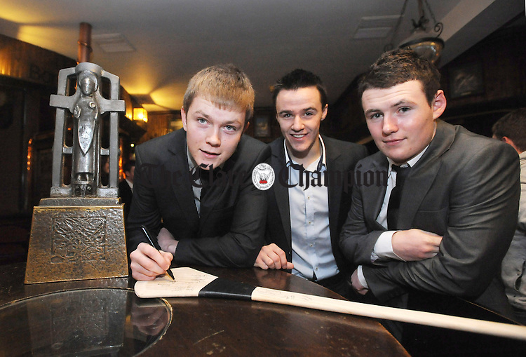 Aaron Cunningham, Jarlath Colleran and David O' Halloran at the Clare U-21 hurling medal presentation night at the West County Hotel in Ennis. Photograph by Declan Monaghan