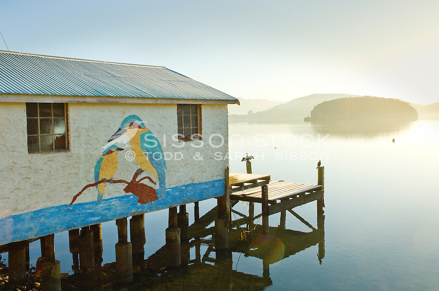 Boatshed, Pudding Island in the background, near Portobello on the Otago Peninsula, South Island, New Zealand - stock photo, canvas, fine art print