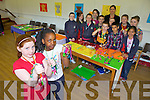 JUNIOR ENTREPRENEUR: Pupils from Balloonagh Primary School made colourful bracelets as part of the Junior Entrepreneur Programme this week. Pictured were: Ciara O'Mahony and Fadzai Mujokoro with Lorraine Kelly, Shannon Hanbridge, Alex Rowan, Joshua McGuire, Adam Tahir, Alexandra Gadong, Chloe Lawlor, Aidan Davis, Odhran O'Hanlon, Aoife Dillon, Madeline McCarthy and Lauren McCarthy.