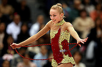 Inna Zhukova of Belarus gives smile during rope routine  at 2006 Aeon Cup Worldwide Club Championships in rhythmic gymnastics on November 19, 2006 at Mie, Japan.  ..<br />
