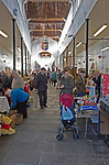 Shoppers inside the historic Shambles market hall in Devizes, Wiltshire, England, UK