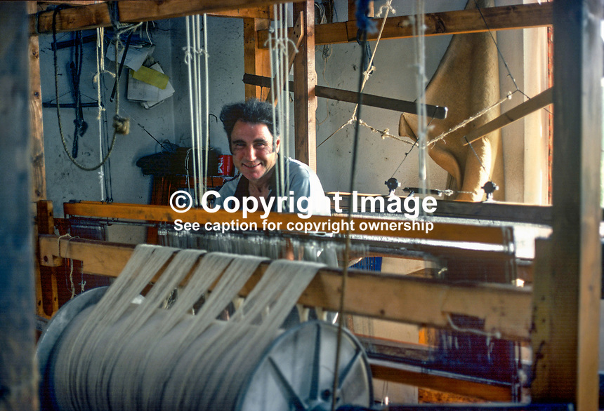Home weaver and his loom, Ardara, Co Donegal, Rep of Ireland. 197809000246a..Copyright Image from Victor Patterson, 54 Dorchester Park, Belfast, United Kingdom, UK...For my Terms and Conditions of Use go to http://www.victorpatterson.com/Victor_Patterson/Terms_%26_Conditions.html