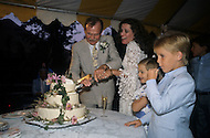 Ketchum, Idaho, U.S.A, August, 5th, 1989. Jack Hemingway and his second wife  Angela Holvey cutting their wedding cake.