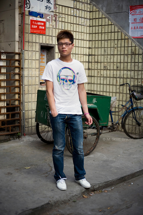 Luhaoyue, a hairstylist, age 20, poses for a portrait in Nanjing. Response to 'What does China mean to you?': 'A wonderful country.'  Response to 'What is your role in China's future?': 'I am a contribution to this large family.'
