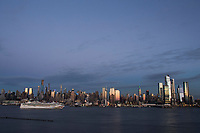WEEHAWKEN NYJ- FEBRUARY 20: The Norwegian Gem cruise ship departs as the New York skyline is seen on February 26, 2019 from Weehawken New Jersey. (Photo by Kena Betancur/VIEWpress/