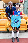 Mark Bright poses for photo with child for the launch of the Premier League Asia Trophy 2017 at the Hong Kong Football Club on 01 June 2017 in Hong Kong, China. Photo by Chris Wong / Power Sport Images