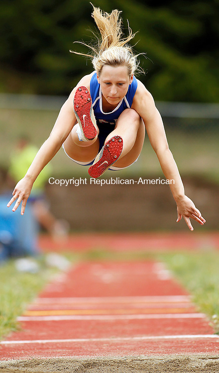 Woodbury, CT-01 May 2012-050112CM02-  Nonnewaug's Grace Cvancigor sails through the air in the long jump during a track meet Tuesday afternoon at Nonnewaug High School in Woodbury.  The Chiefs welcomed Litchfield and Wamogo to the Berkshire matchup.   Christopher Massa Republican-American