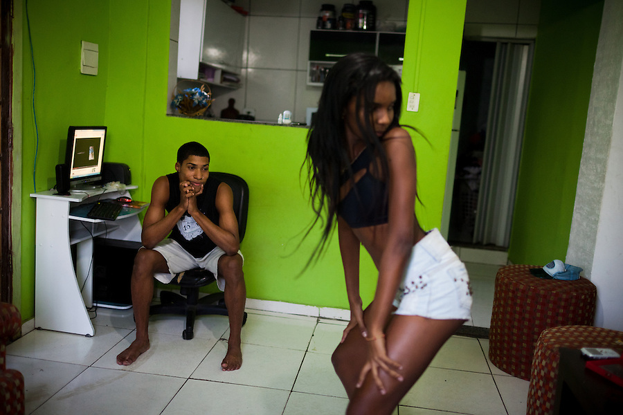 "Tais Castro, 14, right, practices ""twerking"" with Wellington Costa, 19, left, in Cidade de Deus, in Rio de Janeiro, Brazil, on Friday, May 8, 2013. Cidade de Deus, a favela in the west zone was pacified in 2009. Passinho is liberated dance form born from the favelas, incorporating a more feminine dance expression that baile funk repressed, but without the hypersexualized lyrics in the music."