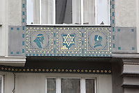 Detail of a decorative panel under a window on a house in the Jewish quarter or Josefov, with a star of David and piles of money and 2 medallions depicting profile silhouettes of a man and a woman, Prague, Czech Republic. The historic centre of Prague was declared a UNESCO World Heritage Site in 1992. Picture by Manuel Cohen