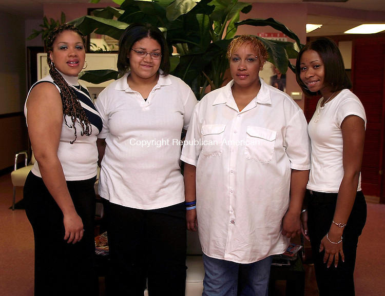 WATERBURY, CT- 26 JUNE 2005- 062605DA01.JPG - Images of Beauty. L-R (owner and stylist) Wanda Terry, (Receptionist) Iesha Robinson, (Locttician braider) Annette Dupre, and (Stylist and makeup artist) Jasmine Woolfolk For Marketplace. Staff Photo. Darlene Douty